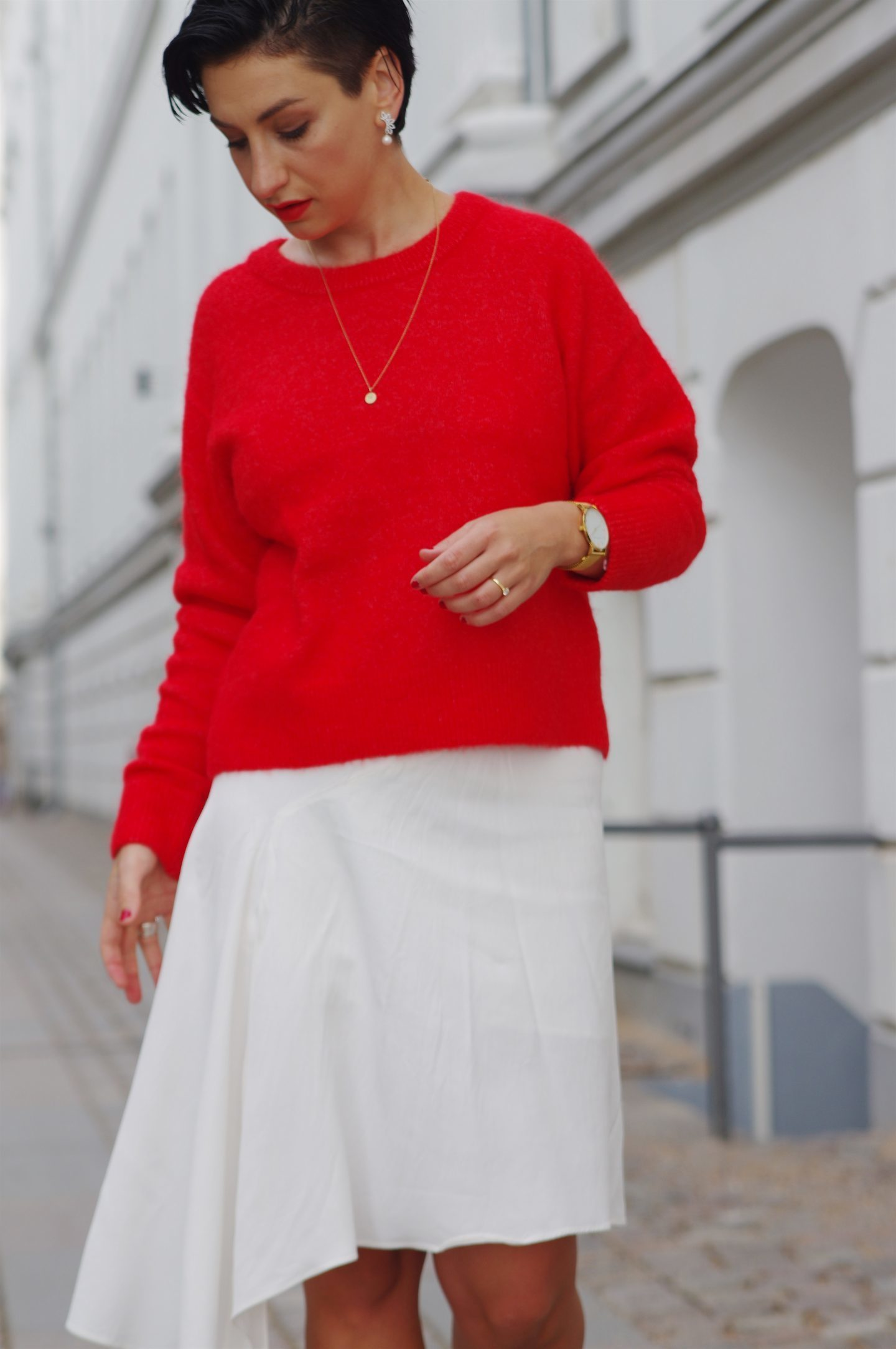 Red sweater and white skirt scandinavian fashion