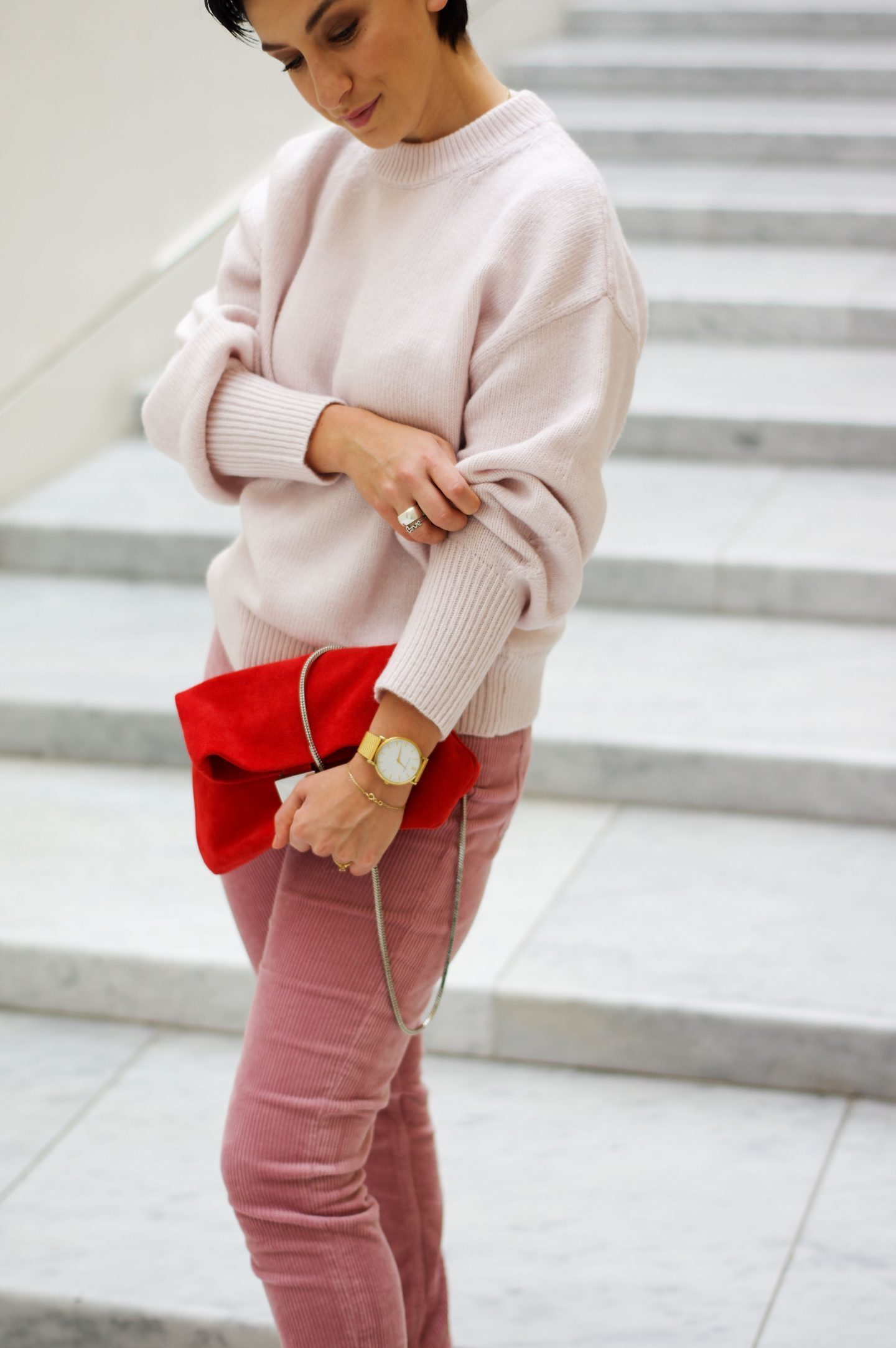Corduroy trousers and sweater outfit pink and red combination