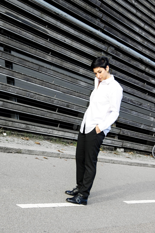 women dressed in mens wear, white shirt, black pants work wear, fashion women